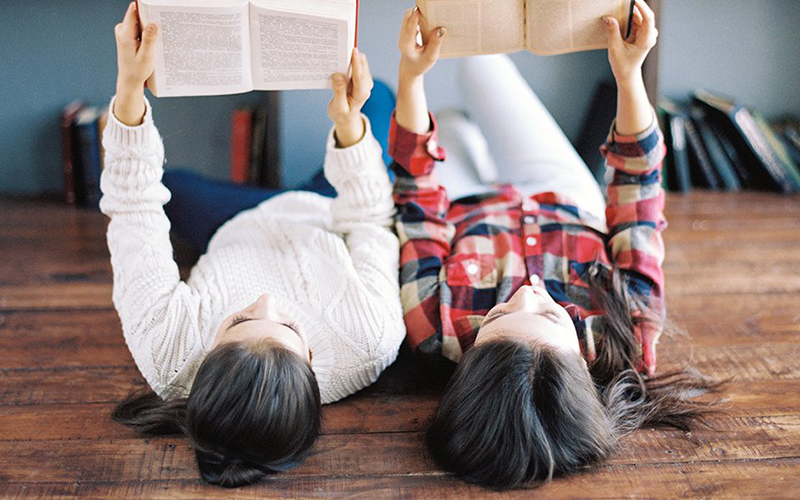Students Studying While Lying On The Floor